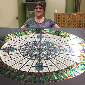 Jane Bergman with her replica of the Altgeld Hall glass dome.